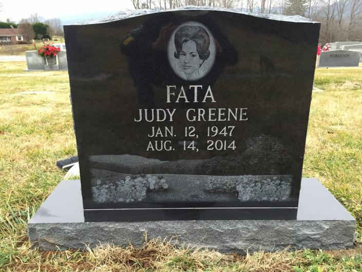 This upright granite monument was laser sketched with a special scene to honor a special woman.